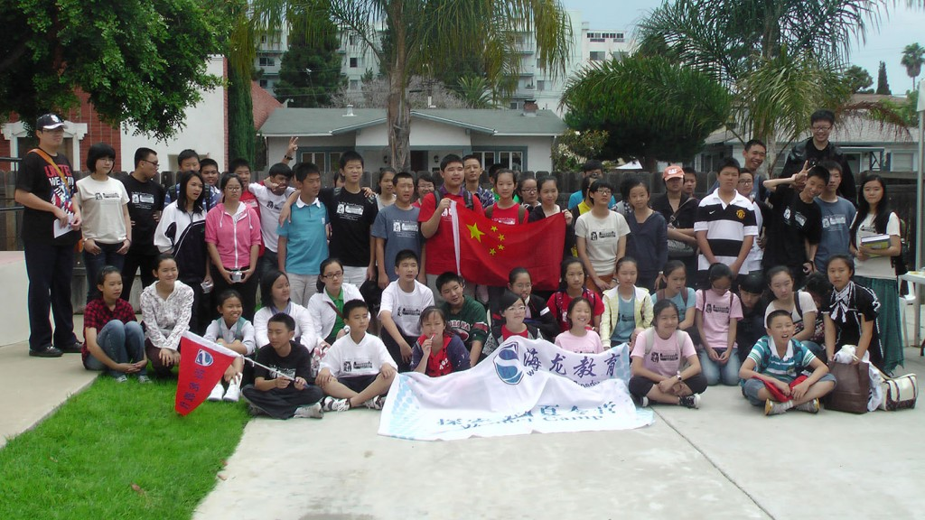 Chinese students pose for a picture outside their ESL classroom
