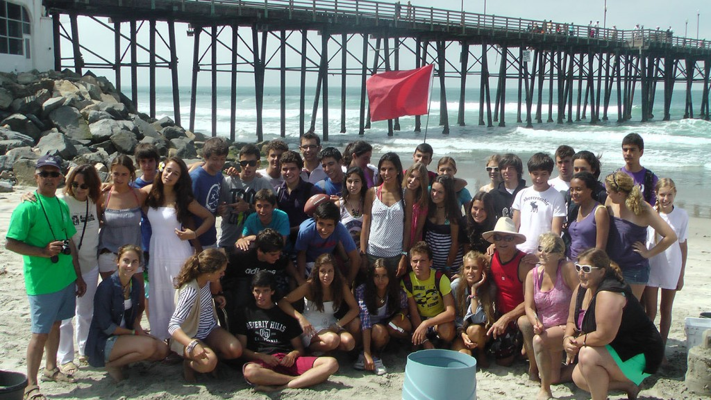 Spanish students pose for picture after a Sand Castle Class