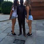 Student and host sister kissing statue in Barcelona